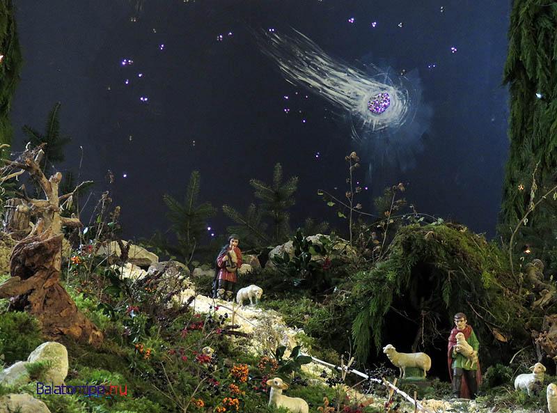 Pásztor fiú dudával és egy másik báránnyal a csodát jósoló égbolt alatt